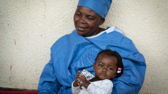 Ebola survivor Masima Masema is looking after 7-month old Airelle while the girl
