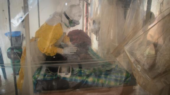 Inside the cubes, nurses and doctors still wear protective gear, even though they have all been vaccinated. If patients come early, there are therapeutic treatments that give them a chance. But almost 70% of Ebola victims have died in this outbreak, many before they even got to a treatment center.