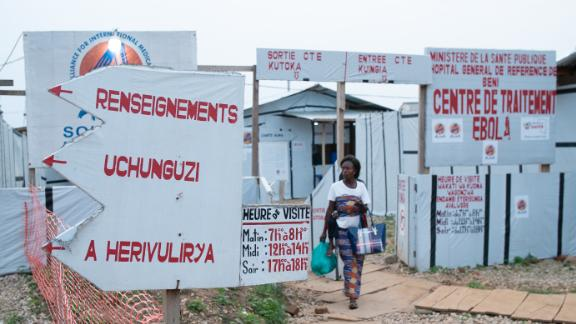 A woman leaves an Ebola treatment center in Beni, in the eastern part of the Democratic Republic of Congo (DRC). Mistrust and insecurity have stopped many from getting treatment. In this outbreak, up to a third of Ebola cases are confirmed only after their bodies are discovered in the community.