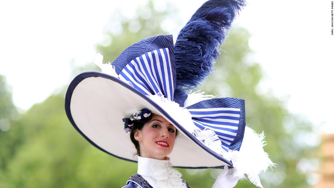 A racegoer takes Royal Ascot's famous dress code to new heights with a larger-than-life hat.