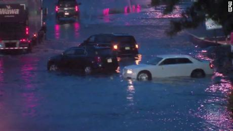 Philadelphia-area flooding: Rescuers help people from flooded cars