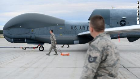 A team of 12th Aircraft Maintenance Unit Airmen walk beside an RQ-4 Global Hawk while it's being towed during Red Flag Alaska 18-3, Aug. 16, 2018, at Eielson Air Force Base, Alaska. This marks the first time an RQ-4 has landed in Alaska during a simulated combat training exercise. (U.S. Air Force photo by Airman 1st Class Tristan D. Viglianco)
