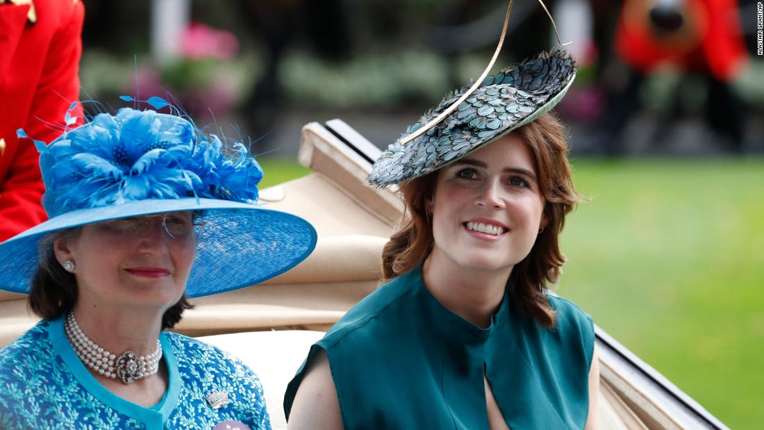 Like a number of other British royals at this year's event, Princess Eugenie, right, embraced a blue color palette.