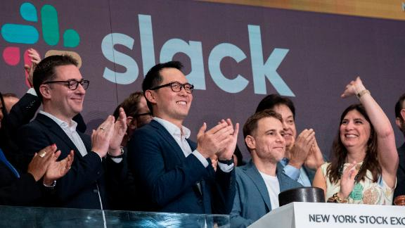 NEW YORK, NY - JUNE 20: Stewart Butterfield (C), co-founder and chief executive officer of Slack, and Allen Shim (2nd L), chief financial officer of Slack, ring the opening bell the New York Stock Exchange (NYSE), June 20, 2019 in New York City. The workplace messaging app Slack will list on the New York Stock Exchange this morning. NYSE set the reference price for the direct listing at $26 per share late on Wednesday. (Photo by Drew Angerer/Getty Images)