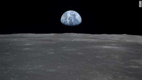 "View of Moon limb with Earth on the horizon,Mare Smythii Region. Earth rise. This image was taken before separation of the LM and the Command Module during Apollo 11 Mission. Original film magazine was labeled V. Film Type: S0-368 Color taken with a 250mm lens.  Approximate photo scale 1:1,300,000. Principal Point Latitude was 3 North by Longitude 85 East. Foward overlap is 90%. Sun angle is High. Approximate Tilt minimum is 65 degrees,maximum is 69. Tilt direction is West (W).  AS11-44-6551 (July 1969) --- This view from the Apollo 11 spacecraft shows the Earth rising above the moon's horizon. The lunar terrain pictured is in the area of Smyth's Sea on the nearside. Coordinates of the center of the terrain are 85 degrees east longitude and 3 degrees north latitude. While astronauts Neil A. Armstrong, commander, and Edwin E. Aldrin Jr., lunar module pilot, descended in the Lunar Module (LM) ""Eagle"" to explore the Sea of Tranquility region of the moon, astronaut Michael Collins, command module pilot, remained with the Command and Service Modules (CSM) ""Columbia"" in lunar orbit."