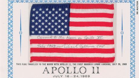 A flown American flag signed by Pilot Michael Collins is expected to sell for at least $60,000.