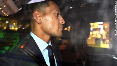 Folau leaves after a code of conduct hearing in Sydney.