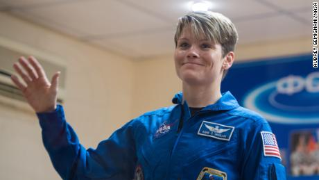 Expedition 58 Flight Engineer Anne McClain of NASA waves during a press conference, Sunday, Dec. 2, 2018 at the Cosmonaut Hotel in Baikonur, Kazakhstan. Launch of the Soyuz rocket is scheduled for Dec. 3 and will carry McClain, Soyuz Commander Oleg Kononenko of Roscosmos, and David Saint-Jacques of the Canadian Space Agency (CSA) into orbit to begin their six and a half month mission on the International Space Station. Photo Credit: (NASA/Aubrey Gemignani).
