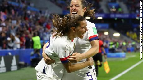 Heath celebrates with Kelley O'Hara after the US' second goal.