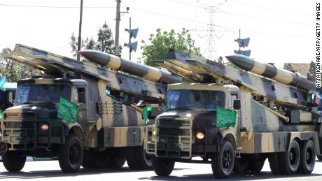 Iranian military trucks carry surface-to-air missiles during a parade on the occasion of the country's Army Day, on April 18, 2017, in Tehran. / AFP PHOTO / ATTA KENARE        (Photo credit should read ATTA KENARE/AFP/Getty Images)