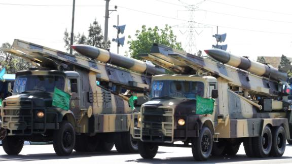 Iranian military trucks carry surface-to-air missiles during a parade on the occasion of the country
