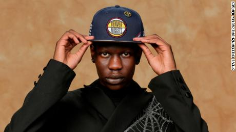 Bol Bol poses for a portrait in a Denver Nuggets hat.