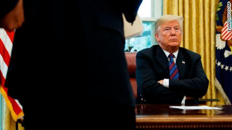 "President Donald Trump sits at his desk after talking with Mexican President Enrique Pena Nieto on the phone in the Oval Office of the White House, Monday, Aug. 27, 2018, in Washington. Trump is announcing a trade ""understanding"" with Mexico that could lead to an overhaul of the North American Free Trade Agreement. Trump made the announcement Monday in the Oval Office, with Mexican President Enrique Pena Nieto joining by speakerphone. (AP Photo/Evan Vucci)"