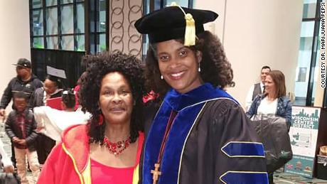 Marijuana Pepsi Vandyck (right) with her mother, Maggie Johnson, at her graduation in May. Vandyck received her doctorate in educational leadership.