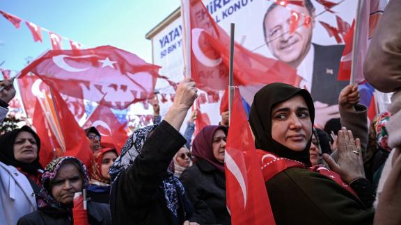 AKP supporters wave Turkish flags at a campaign rally in Kasımpaşa in March.