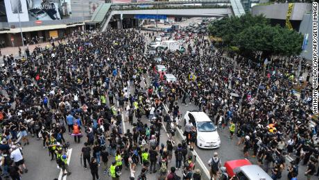 Protesters occupy a street main street in front of the seat of government in Hong Kong on June 21, 2019.