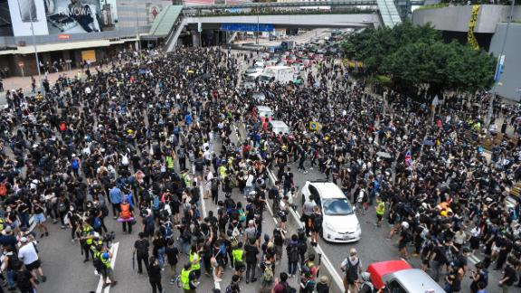 Protesters occupy a main road outside the government headquarters in Hong Kong on June 21, 2019.