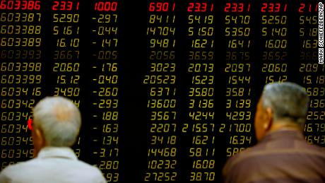 Chinese investors monitor stock prices at a brokerage house in Beijing, Tuesday, Sept. 26, 2017. Asian stocks were little changed Tuesday as investors watched U.S.-North Korean tensions after a decline in tech shares dragged down Wall Street. (AP Photo/Mark Schiefelbein)