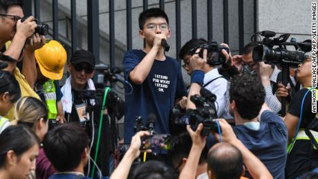 Pro-democracy activist Joshua Wong speaks to protesters outside the police headquarters in Hong Kong on June 21, 2019.