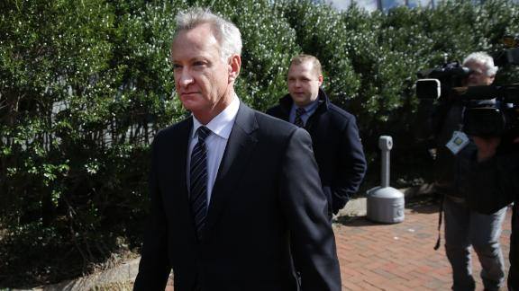 Toby MacFarlane leaves the federal courthouse in Boston on April 3.