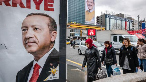 On 16 March, 2019, political campaign posters and banner ads for Turkey's municipal elections featuring Turkish President Recep Tayyip Erdogan and Mehmet Ozhaseki, the mayoral candidate for Ankara from the ranks of the ruling Justice and Development Party (AKP), hang over pedestrians walking in the streets of central Ankara, Turkey. (Photo by Diego Cupolo/NurPhoto via Getty Images)