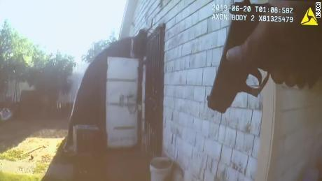 The camera shows the police approaching the garage before the suspect fired.