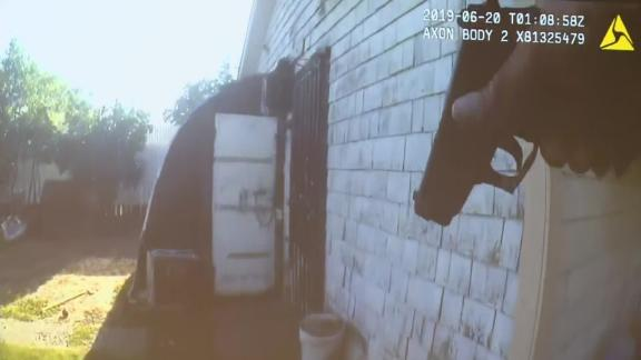 Body camera footage shows police approach the garage before the suspect fired.