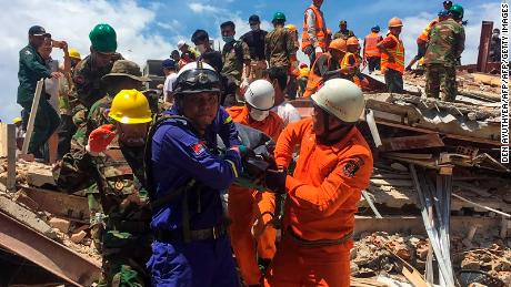 Rescue workers remove a victim from the debris after an under-construction building collapsed in Sihanoukville on June 22, 2019. - At least three people died when an under-construction building collapsed at a Cambodian beach resort early on June 22, officials said, with fears an unknown number of others may still be buried in the rubble. (Photo by Den AYUTHYEA / AFP)        (Photo credit should read DEN AYUTHYEA/AFP/Getty Images)