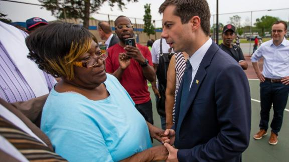 South Bend Mayor Pete Buttigieg shares a moment with Shirley Newbill, the mother of shooting victim Eric Logan.