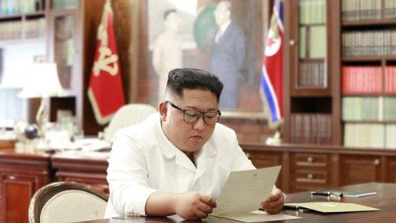 This undated photo provided by the North Korean government shows what appears to be Kim Jong Un reading a letter from US President Donald Trump.