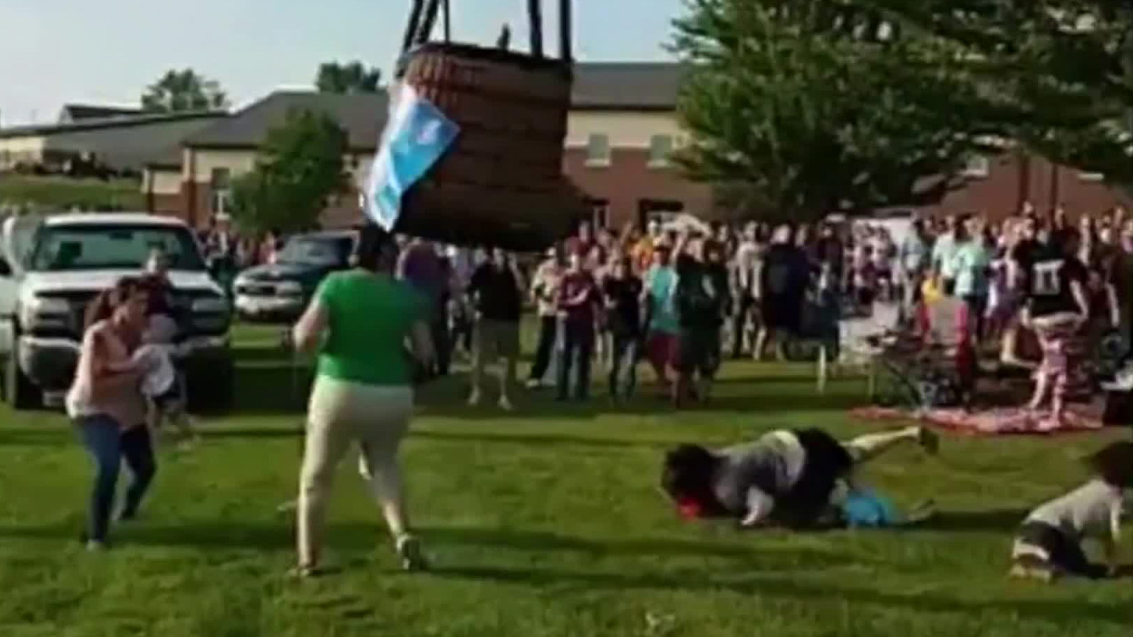 Moment hot air balloon crashes into crowd