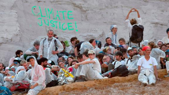 Hundreds of climate change activists staged a blockade in one of Germany's largest coal mines to protest against the country's ongoing dependence on fossil fuels.