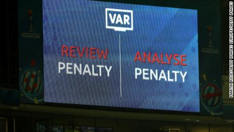 An LED screen shows a VAR review is in place over a penalty decision at the Women's World Cup.