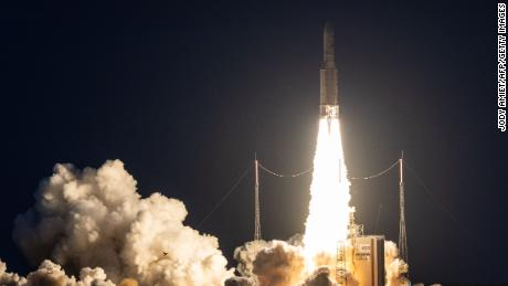 TOPSHOT - An Ariane 5 lifts off from its launchpad in Kourou, at the European Space Center in French Guiana, on June 20, 2019. - It's payload is two satellites, AT&T T-16, a telecommunications satellite build by Airbus Defence and Space, and EUTELSAT 7C. (Photo by jody amiet / AFP)        (Photo credit should read JODY AMIET/AFP/Getty Images)