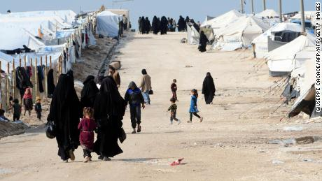 Veiled women, living in al-Hol camp which houses relatives of ISIS group members, walk in the camp in al-Hasakeh governorate in northeastern Syria on March 28, 2019.