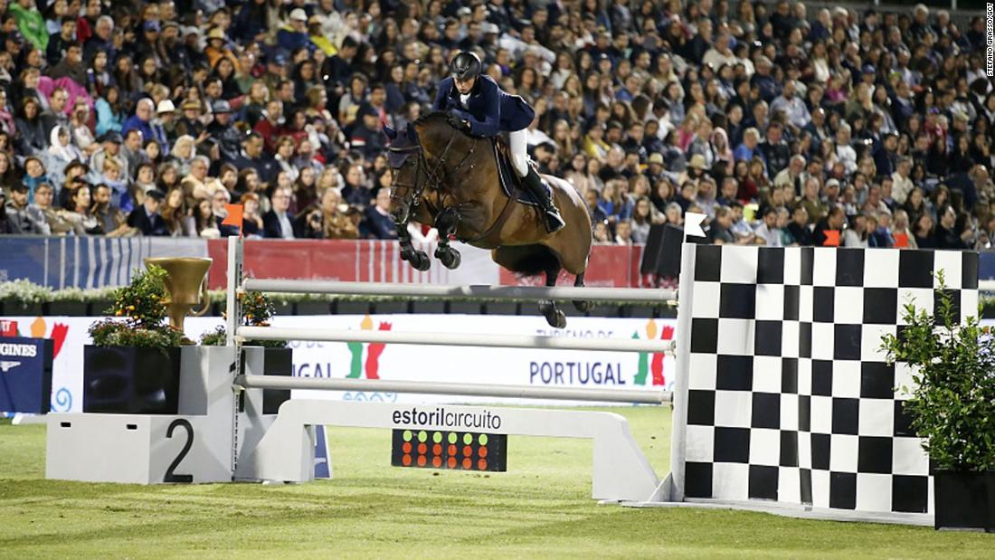 Switzerland's Martin Fuchs clinched double victory by winning both the Longines Global Champions Tour event and partnering Ben Maher to triumph in the Global Champions League for London Knights on the Portuguese coast.