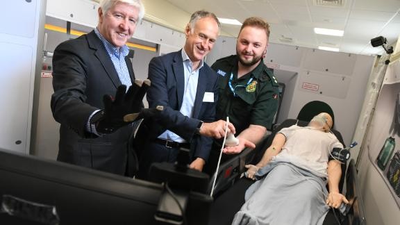 Executives from telecom company BT and a  member of the West Midlands Ambulance Service trial the 5G technology.
