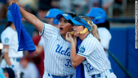 OKLAHOMA CITY, OK - JUNE 4: Brianna Tautalafua #33 and Stevie Wisz #12 of the UCLA Bruins celebrate after a home run against the Oklahoma Sooners during the Division I Women's Softball Championship held at ASA Hall of Fame Stadium-OGE Energy Field on June 4, 2019 in Oklahoma City, Oklahoma. (Photo by Shane Bevel/NCAA Photos via Getty Imagess via Getty Images Photos via Getty Images via Getty Images)
