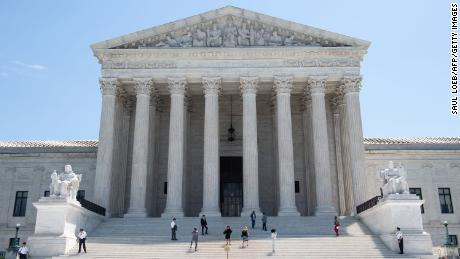 """The US Supreme Court is seen in Washington, DC, June 24, 2019. - The US Supreme Court ruled in favor of the clothing brand FUCT in a free speech case on Monday, saying the name could be trademarked.The nation's highest court, in a 6-3 decision, struck down a federal prohibition on the registration of trademarks deemed to be """"immoral or scandalous.""""The court held that such a prohibition violates the First Amendment right to free speech. (Photo by SAUL LOEB / AFP) (Photo credit should read SAUL LOEB/AFP/Getty Images)"""