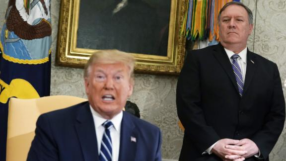 WASHINGTON, DC - JUNE 20:  U.S. Secretary of State Mike Pompeo looks on as President Donald Trump speaks during a meeting with Canadian Prime Minister Justin Trudeau in the Oval Office of the White House June 20, 2019 in Washington, DC. Trump and Trudeau were expected to discuss the trade agreement between the U.S., Canada and Mexico.  (Photo by Alex Wong/Getty Images)