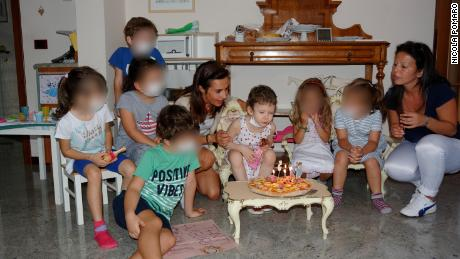 To celebrate birthdays, Angela's friends had to wear masks to ensure their safety. CNN has blurred the faces of other children in the photo to protect their privacy.