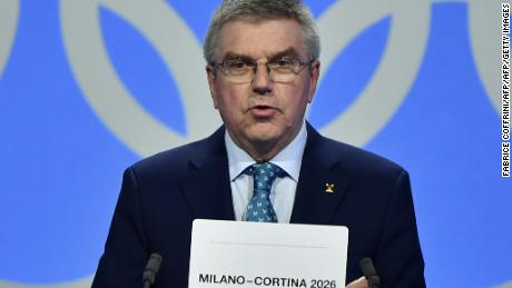 International Olympic Committee (IOC) president Thomas Bach shows the card with the name Milan/Cortina d'Ampezzo as the winning name of the 2026 Winter Olympics during the 134th session of the International Olympic Committee (IOC), in Lausanne on June 24, 2019. (Photo by Fabrice COFFRINI / AFP)        (Photo credit should read FABRICE COFFRINI/AFP/Getty Images)