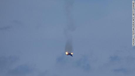 "A burning aircraft of the type ""Eurofighter"" of the Bundeswehr is seen in the sky above Malchow on June 24, 2019. - One pilot was killed after two German fighter jets collided and crashed Monday in the north of the country, an airforce spokesman said, with the reason for the accident unclear. (Photo by Thomas Steffan / dpa / AFP) / Germany OUT        (Photo credit should read THOMAS STEFFAN/AFP/Getty Images)"