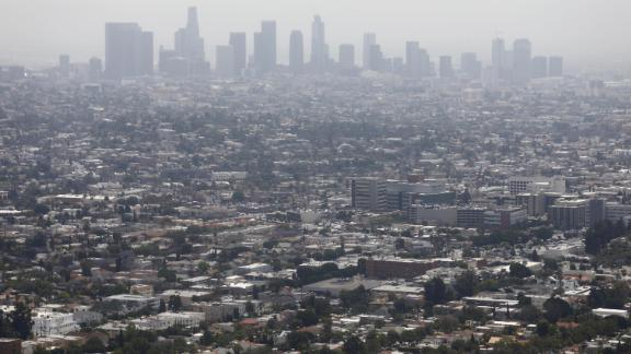 """LOS ANGELES, CALIFORNIA - JUNE 11: Smog hangs over the city on a day rated as having 'moderate' air quality in downtown Los Angeles, on June 11, 2019 in Los Angeles, California. According to the American Lung Association's annual """"State of the Air"""" report, released in April and covering the years 2015-2017, Los Angeles holds the worst air pollution in the nation. The city has had the worst smog, otherwise known as ground-level ozone, in the U.S. for 19 of the past 20 years.  (Photo by Mario Tama/Getty Images)"""