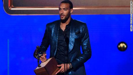 Rudy Gobert, of the Utah Jazz, accepts the NBA defensive player of the year award at the NBA Awards.