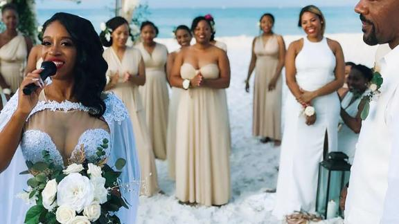 The bride with a few of her bridesmaids nearby