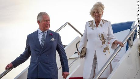 Britain's Prince Charles, Prince of Wales (L) and his wife Britain's Camilla, Duchess of Cornwall (R) disembark from the plane upon their arrival at the airport in Banjul, for an official visit, on October 31, 2018. (Photo by Seyllou / POOL / AFP)        (Photo credit should read SEYLLOU/AFP/Getty Images)