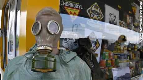 Visitors buy snacks and souvenirs at a souvenir shop next to the Dytyatky checkpoint after a tour in the Chernobyl exclusion zone, on June 7, 2019. - HBOs hugely popular television series Chernobyl has renewed interest around the world on Ukraines 1986 nuclear disaster with authorities reporting a 30% increase of tourist demands to visit the affected area and tourist operators forecasting that number of tourists visiting the site may double this year up to 150.000 persons (Photo by Genya SAVILOV / AFP)        (Photo credit should read GENYA SAVILOV/AFP/Getty Images)
