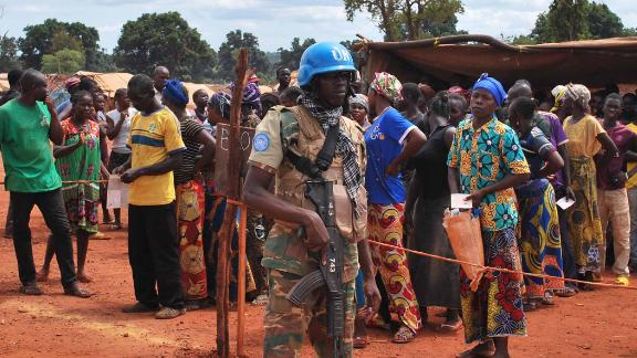 Namibian UN blue helmets stand watch over food distribution in the IDP camp in Bria.