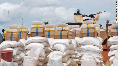 A member of the UN forces guards rations of rice and oil for the sanctuary at Bria.